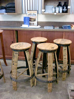The barstools are re-purposed casks.